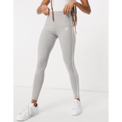 アディダス レディース レギンス ボトムス adidas Originals adicolor 3-stripes logo leggings in gray Grey