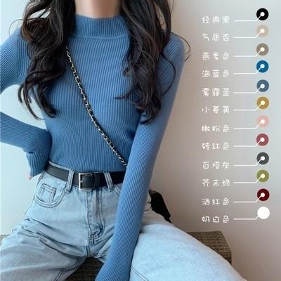 メリヤスの女性の秋の服装の2020新型の100着の純色の打底のシャツの高腰の修身する長袖のセーターのファッション的な上着の女性