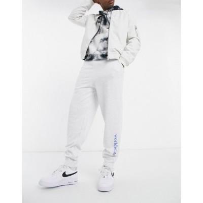 エイソス メンズ カジュアルパンツ ボトムス ASOS DESIGN set oversized sweatpants with text print White marl
