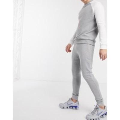 エイソス メンズ カジュアルパンツ ボトムス ASOS DESIGN organic super skinny sweatpants in gray marl with gold zip pockets Gray ma