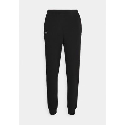 プーマ カジュアルパンツ メンズ ボトムス ESSENTIAL PANTS - Tracksuit bottoms - black