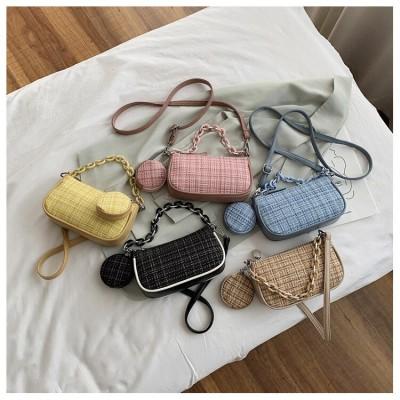 財布ゼロを持参し、今年流行のバッグを持参します。女性用斜め掛けバッグ。