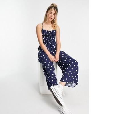 エイソス レディース ワンピース トップス ASOS DESIGN tie front shirred waist culotte jumpsuit in navy & cream spot print Navy cre
