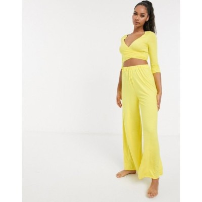 エイソス レディース カジュアルパンツ ボトムス ASOS DESIGN mix & match wide leg jersey pyjama pants in yellow Yellow