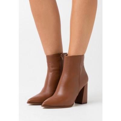 スティーブマデン レディース ブーツ RAYNI - High heeled ankle boots - cognac