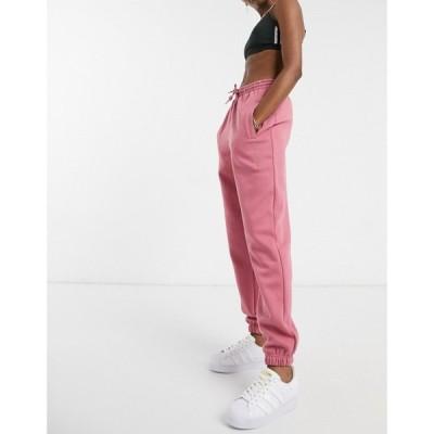 アディダス adidas Originals レディース ジョガーパンツ ボトムス・パンツ 'Cosy Comfort' oversized cuffed joggers in pink ピンク