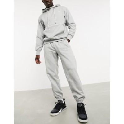 ナイキ メンズ カジュアルパンツ ボトムス Nike Basketball standard issue sweatpants in gray Grey