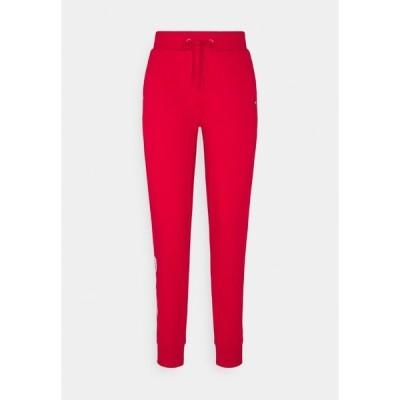 トミー ヒルフィガー カジュアルパンツ レディース ボトムス REGULAR GRAPHIC PANT - Tracksuit bottoms - red