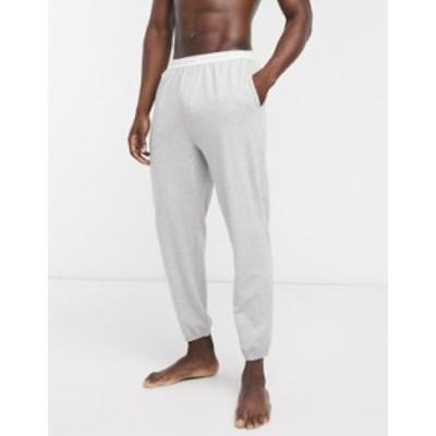 カルバンクライン メンズ カジュアルパンツ ボトムス Calvin Klein Sleepwear contrast logo waistband sweatpants in gray Grey