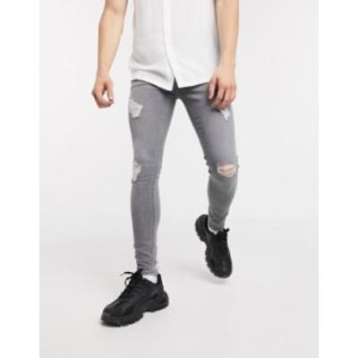 エイソス メンズ デニムパンツ ボトムス ASOS DESIGN spray on jeans with power stretch with heavy rips in gray Gray