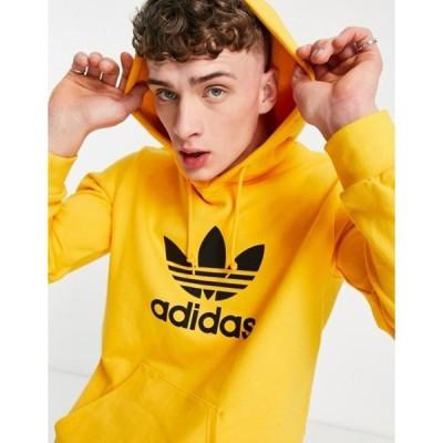 アディダス メンズ パーカー・スウェット アウター adidas Originals large trefoil hoodie in active gold