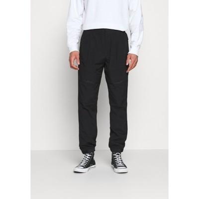 カルバンクライン カジュアルパンツ メンズ ボトムス TRACK PANT - Trousers - black