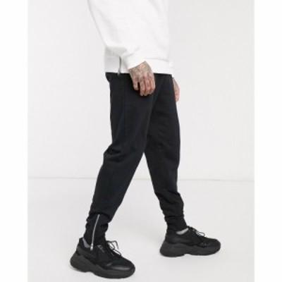 エイソス ASOS DESIGN メンズ ジョガーパンツ ボトムス・パンツ organic tapered joggers in black with silver zip cuffs ブラック