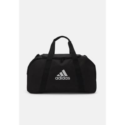 アディダス メンズ ショルダーバッグ バッグ TIRO DU S - Sports bag - black/white black/white