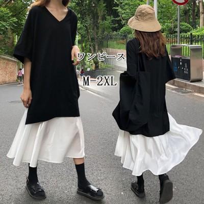 2021春の夏の装いの新型の韓国版のゆったりしているVネックの黒色の半袖のワンピースの裾は長いスカートの女性をつづり合わせます。