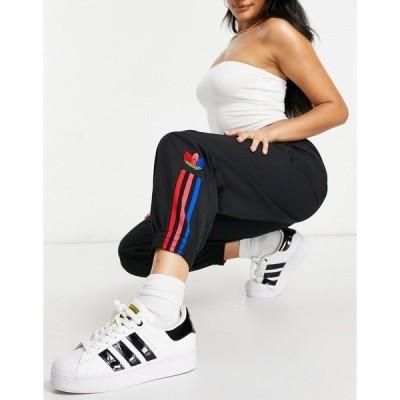 アディダスオリジナルス レディース カジュアルパンツ ボトムス adidas Originals trefoil three stripe track pants in black Black