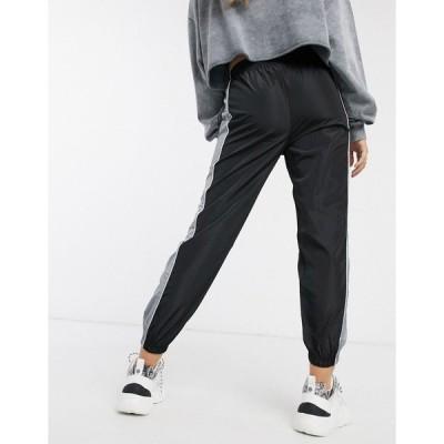 QEDロンドン レディース カジュアルパンツ ボトムス QED London sweatpants with contrasting side panel in black Black/gray