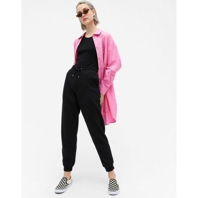 モンキ レディース カジュアルパンツ ボトムス Monki Kardi organic cotton sweatpants in black Black