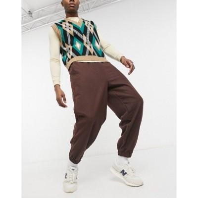 エイソス メンズ カジュアルパンツ ボトムス ASOS DESIGN oversized tapered sweatpants in wool-look in tobacco Tan