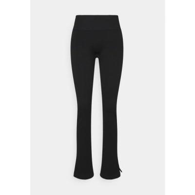 カサル レディース ファッション SEAMLESS SLIT PANTS - Tracksuit bottoms - black