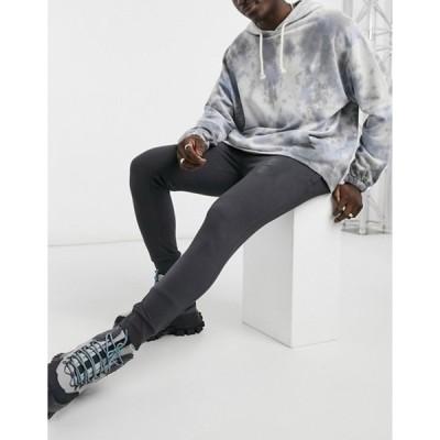 ニッチェ ロンドン メンズ カジュアルパンツ ボトムス Nicce reflective logo panel sweatpants in charcoal gray