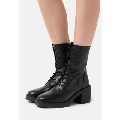 マルコポーロ レディース ブーツ KANDY - Platform ankle boots - black