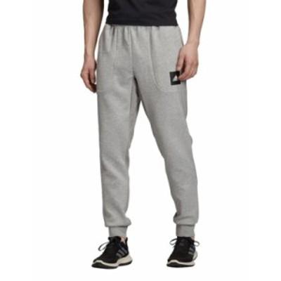 アディダス メンズ カジュアルパンツ ボトムス adidas Training sweatpants in gray Grey