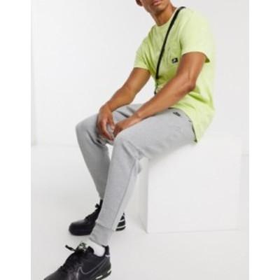ナイキ メンズ カジュアルパンツ ボトムス Nike Tech Fleece joggers in grey Gray