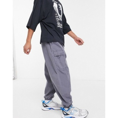 エイソス メンズ カジュアルパンツ ボトムス ASOS DESIGN oversized tapered sweatpants with cargo pockets in washed blue Blue