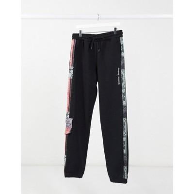 クリミナルダメージ メンズ カジュアルパンツ ボトムス Criminal Damage bandana print sweatpants in black
