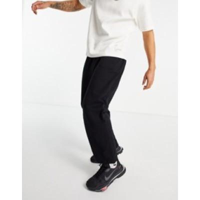 エイソス メンズ カジュアルパンツ ボトムス ASOS DESIGN super organic oversized sweatpants in black with toggle hem Black