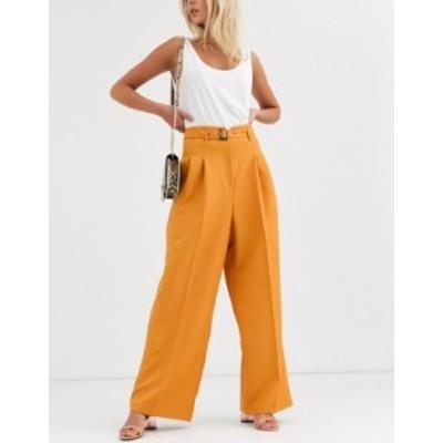 エイソス レディース カジュアルパンツ ボトムス ASOS DESIGN belted pleat front wide leg pants Orange