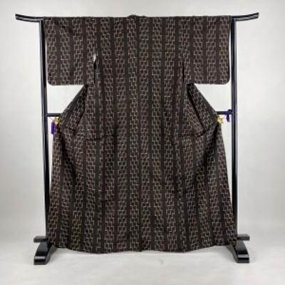 紬 美品 名品 幾何学 焦茶色 袷 身丈166.5cm 裄丈64cm M 正絹 中古