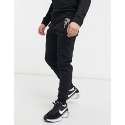 リバーアイランド メンズ カジュアルパンツ ボトムス River Island jersey sweatpants with print in black Black