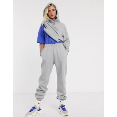 ナイキ レディース カジュアルパンツ ボトムス Nike mini swoosh oversized sweatpants in gray Grey