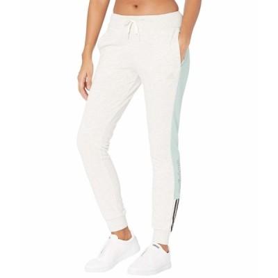 アディダス カジュアルパンツ ボトムス レディース Linear Tricot Cuffed Pants Off-White Melange/Black
