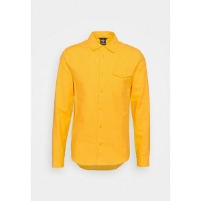 ナイキ メンズ シャツ トップス SOLID UNISEX - Shirt - university gold university gold
