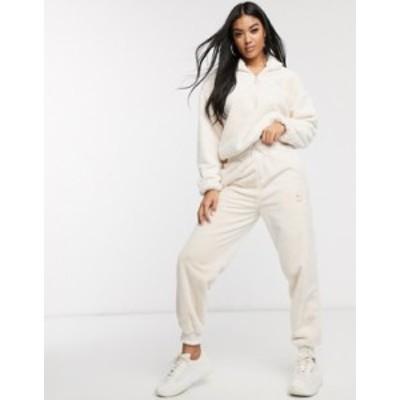 プーマ レディース カジュアルパンツ ボトムス Puma winter classics faux fur sweatpants in cream Cream