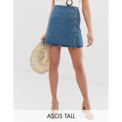 エイソス レディース スカート ボトムス ASOS DESIGN Tall denim wrap skirt with buttons in midwash blue Midwash blue