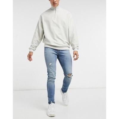 エイソス メンズ デニムパンツ ボトムス ASOS DESIGN skinny jeans in vintage mid wash blue with knee rip and abrasions