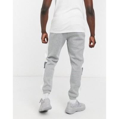 ナイキ メンズ カジュアルパンツ ボトムス Nike color block cuffed sweatpants in dark gray Dark gray