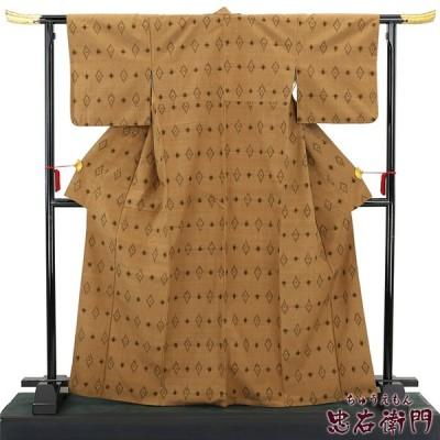 中古  おしゃれな絣柄の紬 リサイクル 正絹 広衿 ブラウン カジュアル レディース 裄67cm あすつく対応